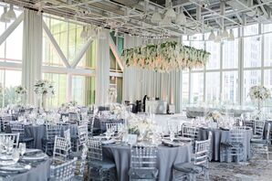 Lucite Chiavari Chairs with Blue Tablecloths Under Hanging Hydrangea Installation