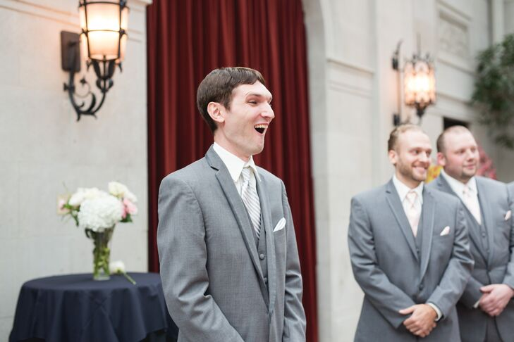 Justin stood at the front of the altar when Elon walked into the ceremony space, and his mouth dropped at the first look of his bride. Justin wore a light gray suit by American Commodore Tuxedo with an ivory silk tie that matched Elon's wedding dress. The groomsmen matched Justin, wearing the same-colored suit and tie.