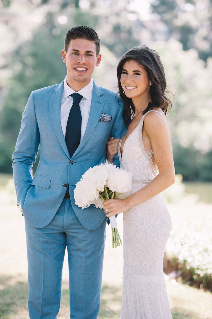 Michael's light blue suit (worn with a pocket square instead of a boutonniere) was a relaxed yet refined complement to Molly's form-fitting, beaded Inbal Dror gown.