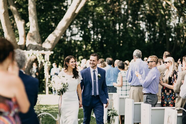 Outdoor Recessional Between White Pews