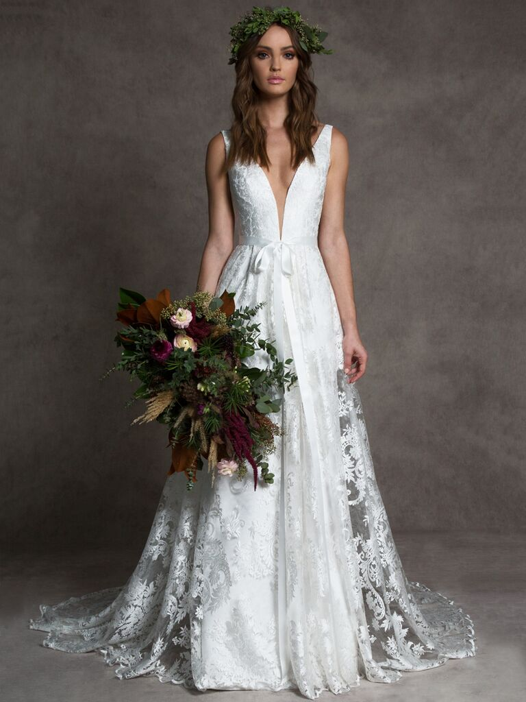 Romona New York Fall 2019 wedding dress with a plunging neckline and front bow detail