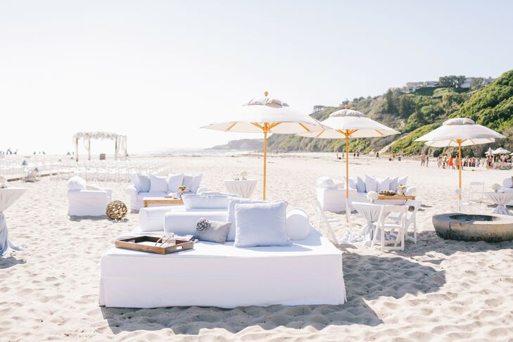 Immediately after the beach ceremony, guests enjoyed cocktails and relaxed on lounging vignettes set up on the sand.