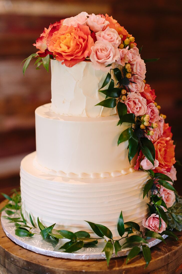 Wedding Cake Accented with Coral and Pink Roses