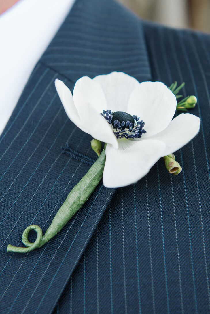 The groom wore a simple white anemone boutonniere.