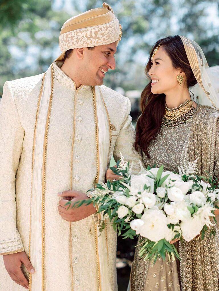 Bride wearing neutral embellished Indian wedding dress