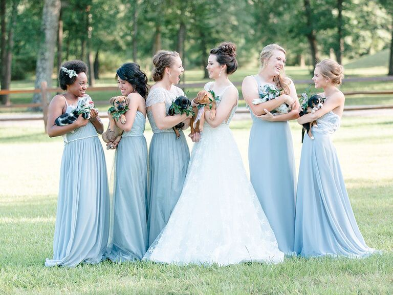 bride and bridesmaids holding rescue puppies for bouquets