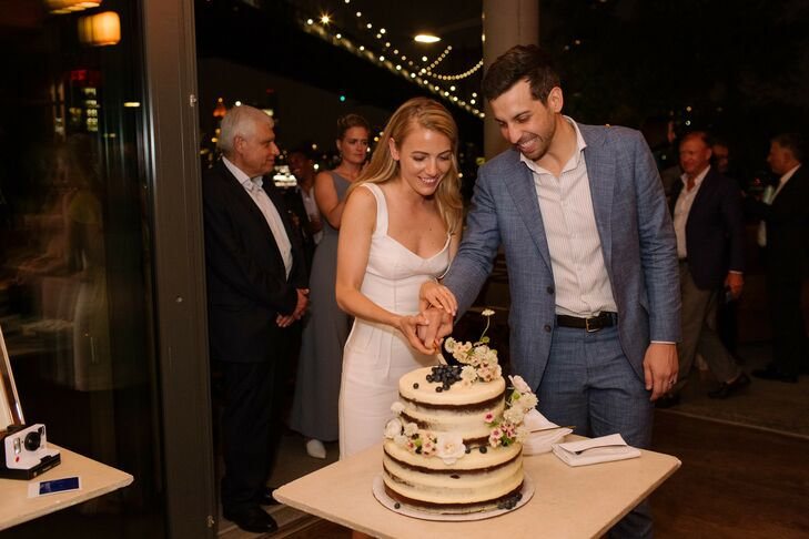Couple Cutting a Modern Semi-Naked Cake with Flowers