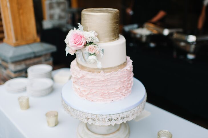 """Our three-layer cake was ivory, blush and gold, and I searched everywhere for a gold cake server set, which I finally found on eBay,"" Amber says. ""It was the perfect final touch to our cake table."""