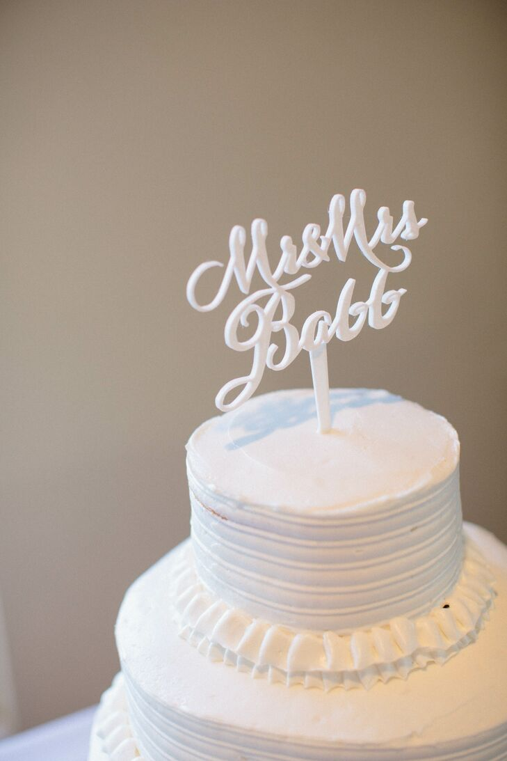 David, an architect, designed and printed this custom cake topper on a 3-D printer. The simple tiered white cake came from Walmart.