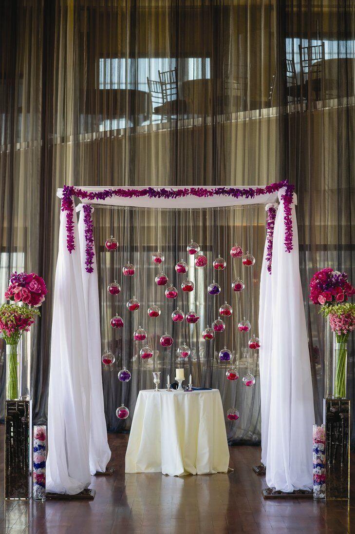 Fabric chuppah with hanging terrariums