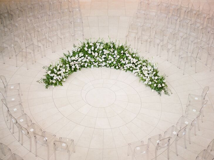 Ceremony in the Round with Greenery Ground Arch and Ghost Chairs