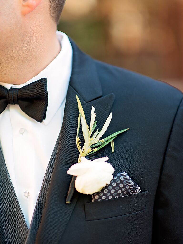 475e08e8133dc Chic boutonniere with a ranunculus and pocket square
