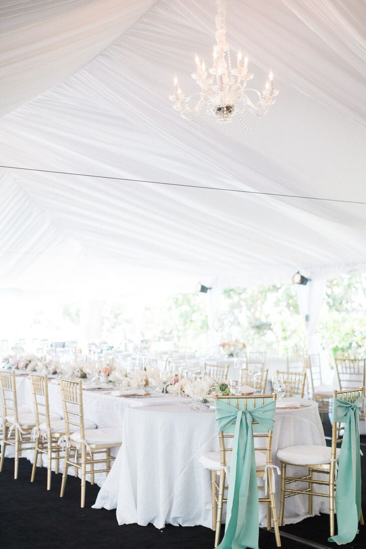 Of course, they also brought Stephanie's favorite color into the reception. The newlyweds' gold chiavari chairs were wrapped in mint sashes and stood out at the head of their wedding party's table.