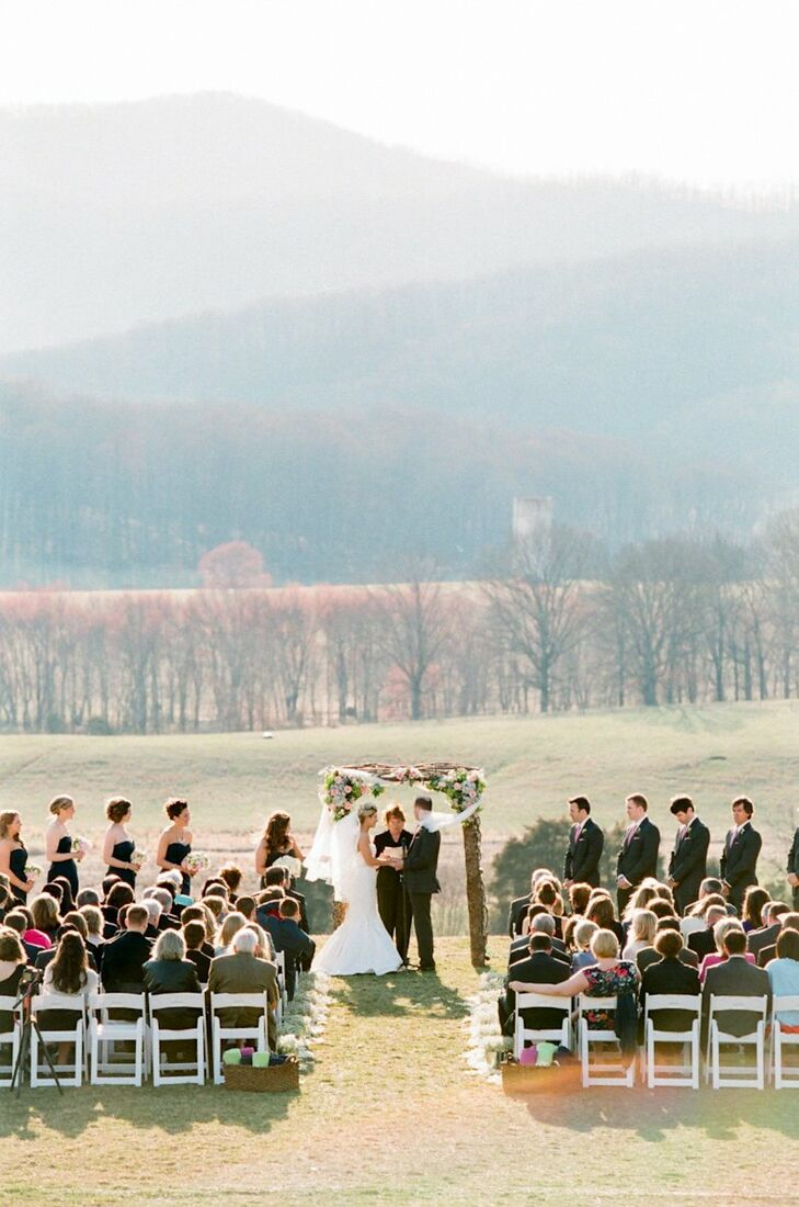 The couple's outdoor ceremony overlooked the forest at the gorgeous Pippin Hill Farm.