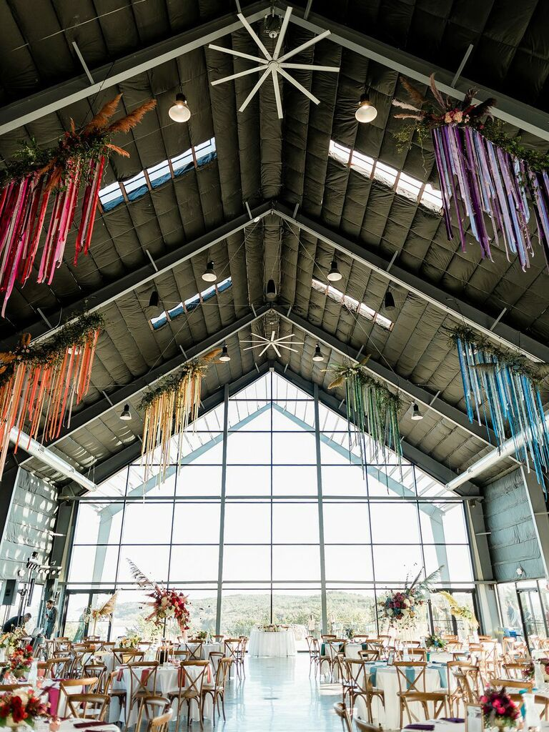 how to choose wedding vendors industrial venue with rainbow ribbons