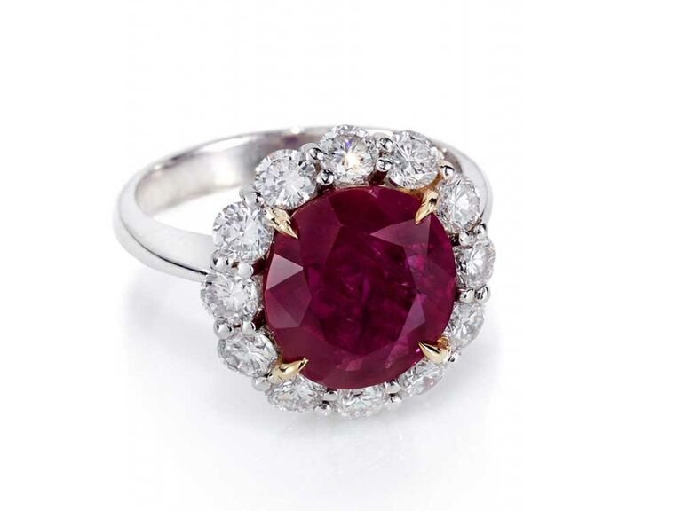 Ruby engagement ring with large diamond cluster halo