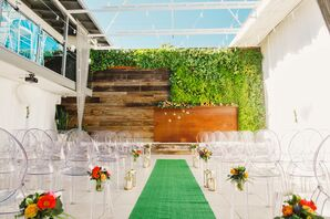 Glass Roof Ceremony with Ghost Chairs and a Green Aisle