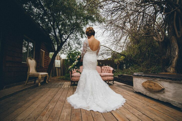 Vanessa always dreamt of wearing a mermaid style wedding dress. Her dress featured a lace overlay with sheer lace sleeves, a low back and a train.
