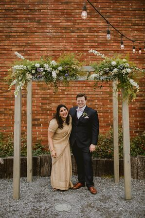 Casual Couple and Wood Wedding Arch