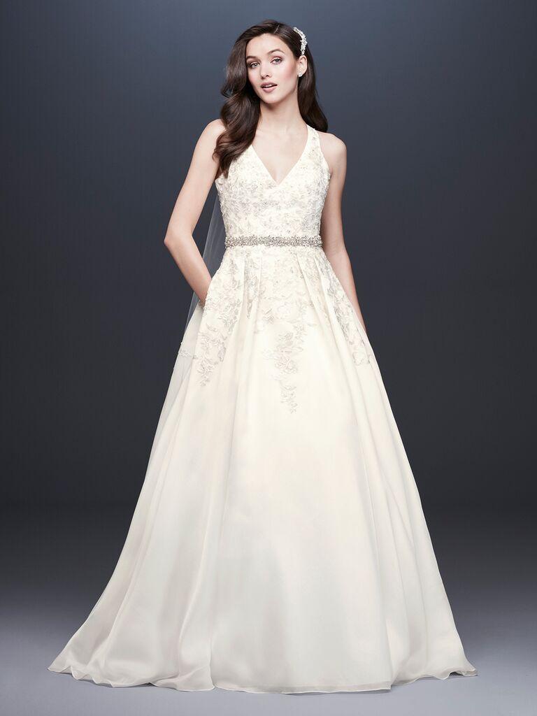 David's Bridal Spring 2019 A-line wedding dress with a full skirt, V-neckline and belt detail