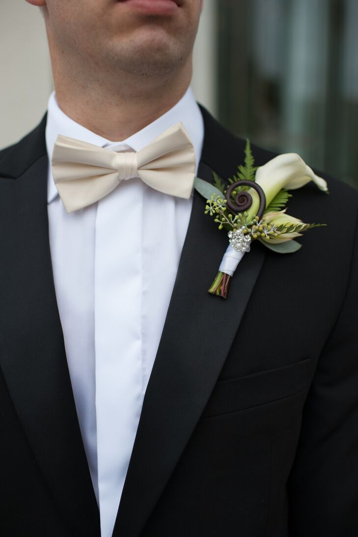 """Dan wore a bespoke black tuxedo with a cream-colored vest and bow tie. """"As a gift to my husband, I got him Kansas University basketball recycled flooring cuff links,"""" Marisa adds. """"They were very special, since he is a huge Jayhawks fan."""""""