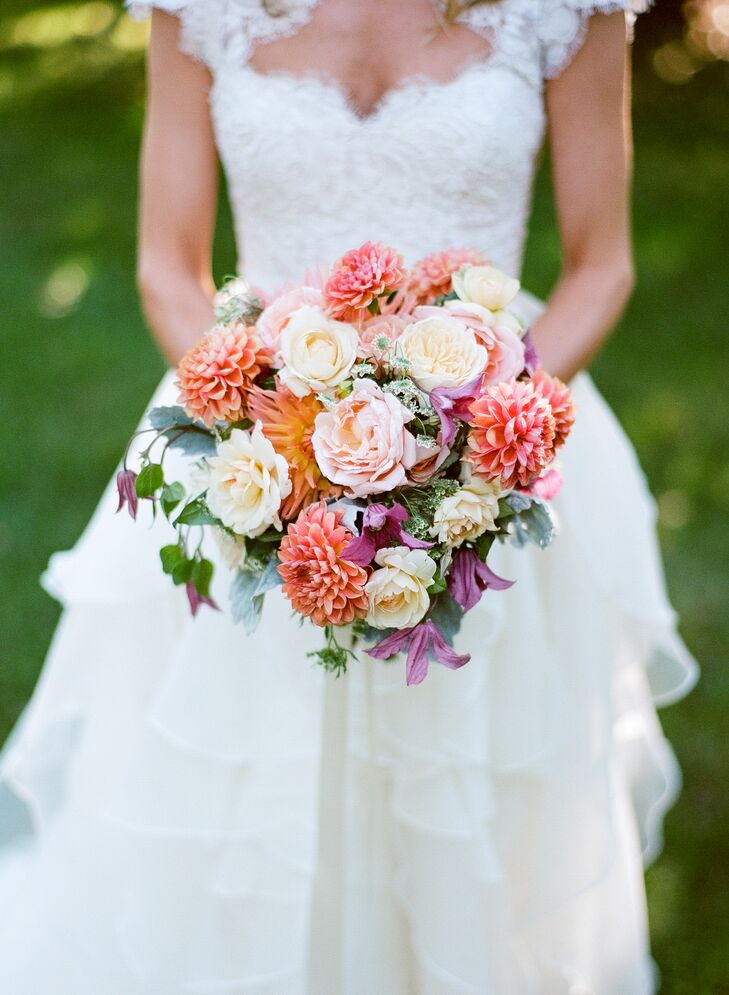 """""""This is going to sound extremely unbridal, but I actually trusted Bess so much that I told her the color scheme and just told her to do what she wanted,"""" Michelle says. """"The only thing I asked her not to incorporate were roses. I was thrilled by the result."""" The fall-inspired bouquet was filled with a fresh mix of dahlias, lisianthus and more in seasonal shades of burnt orange, coral and plum."""