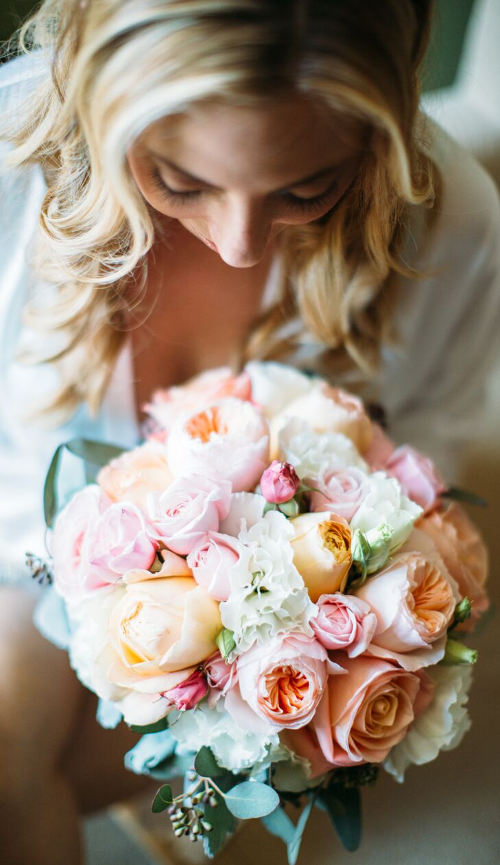 Monique held an elegant bouquet filled with pastel-colored roses and carnations, arranged by Tangled Lotus. The flowers made an appearance in many of the other arrangements that decorated the outdoor space, adding a soft touch to the shabby-chic style.