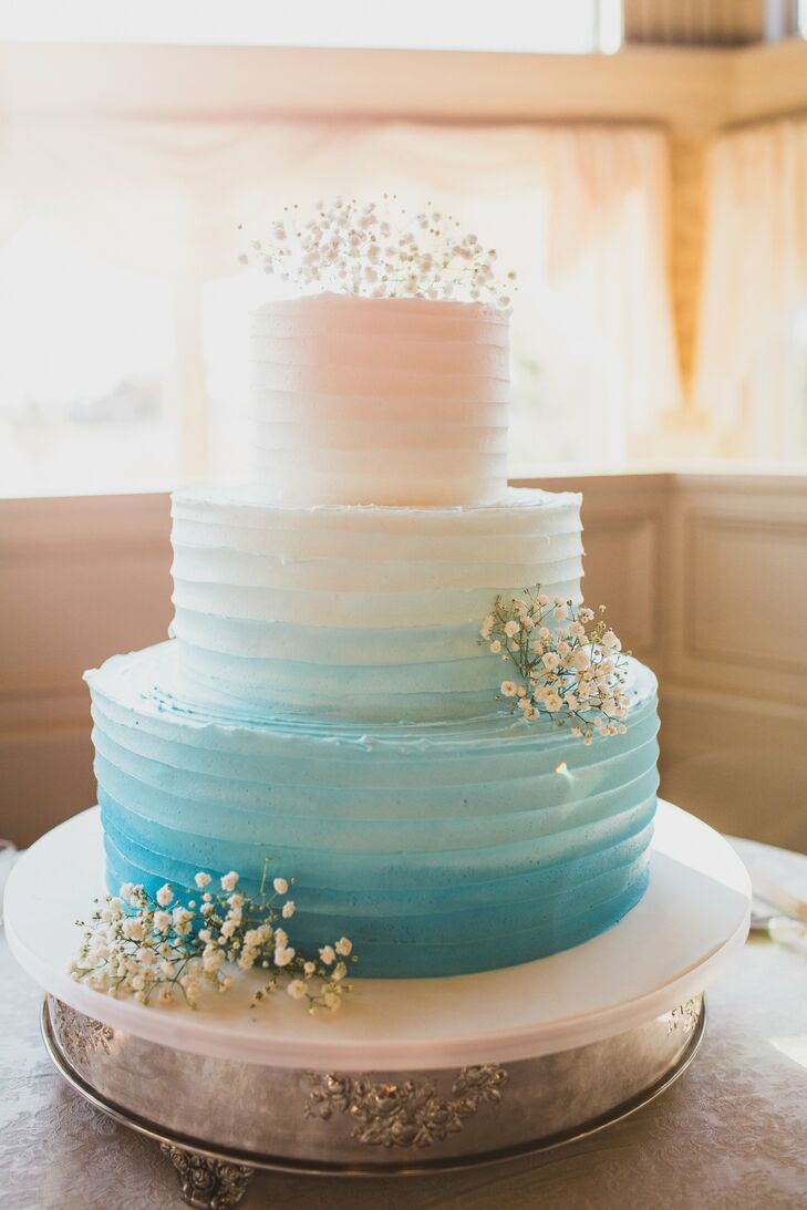 "Since Jodi is a chef, the cake's design and flavor were especially important to them. ""The end result could not have been more perfect, as all the guests mentioned how much they enjoyed the cake,"" Jodi says. Teamed up with the pros at Carlo's Bakery, they designed a blue ombre confection. Salted caramel and vanilla cake filled every layer below thick buttercream icing. Bunches of baby's breath also topped the tiers for an unexpected, natural touch."