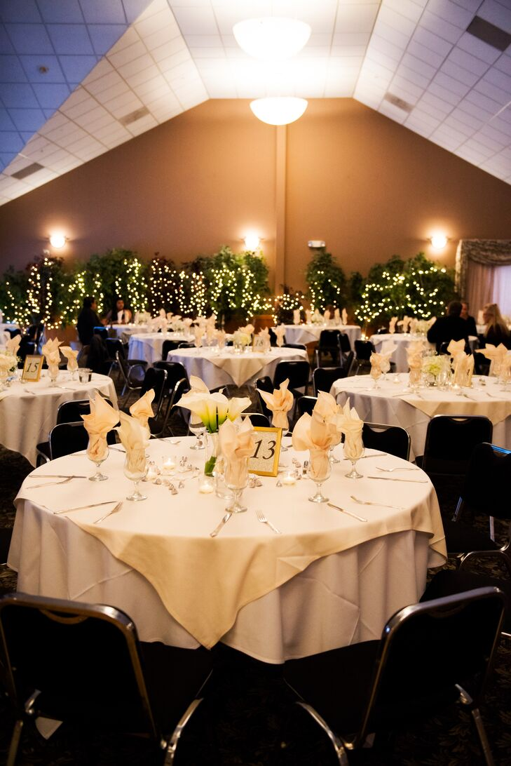 The reception tables were covered in white linens topped with white calla lilies. The couple also added personalized Hershey's Kisses for guests to take home at the end of the night.