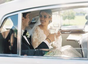 Elegant Couple Toasting in Car