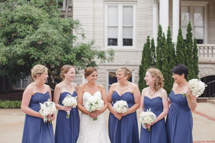 The bridesmaids wore marine blue strapless gowns.