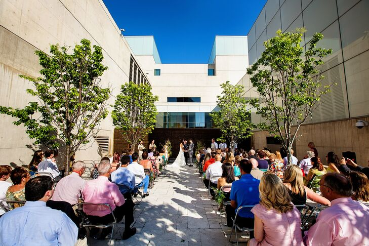 The couple was married in a Christian-based ceremony inside a pocket park next to the museum.