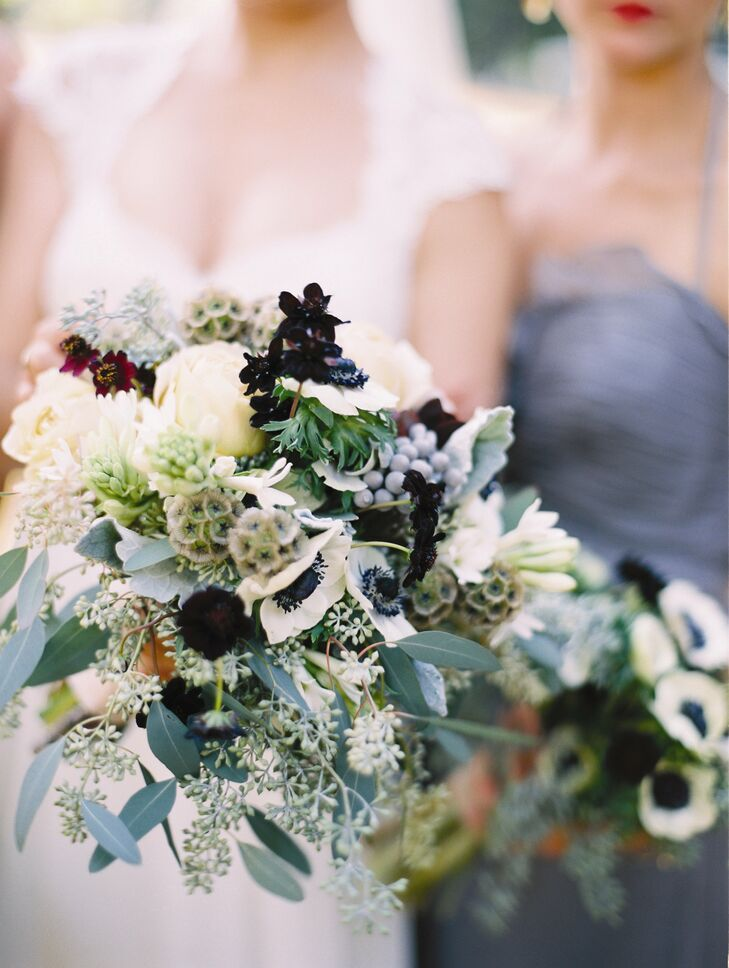 Eve's loose, wildflower bouquet featured cosmos, roses, eucalyptus, brunia berries and anemones.