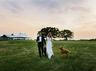 Page Warner and Justin Gruetzner wed at Flying V Ranch Event Venue in Decatur, Texas. The ceremony took place outdoors against a background of trees a