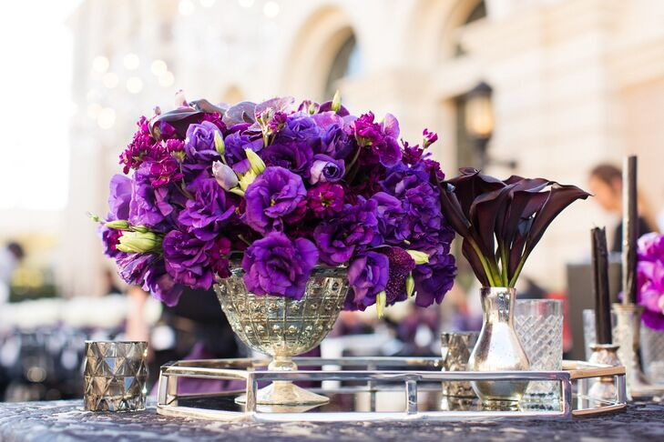 At the reception at Warner Brothers Studio in Hollywood, California, tables were set with silver vases filled with purple blossoms.