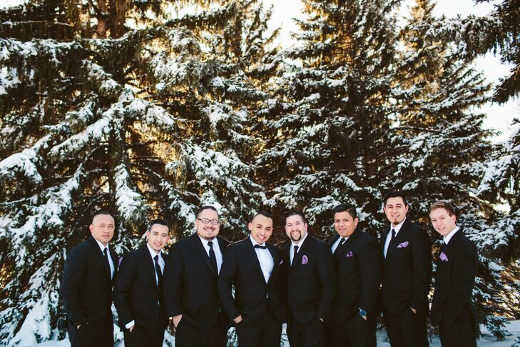 Each groomsmen wore a classic black tuxedo with a black tie and wisteria pocket squares to match the bridesmaid dresses.