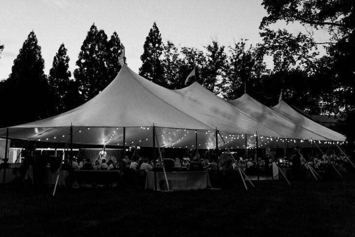After the ceremony, the newlyweds and their guests headed to an open-air tent set up on Buena Vista's expansive lawn for dinner and dancing. As the sun began to set over the mansion, strands of bistro lights came to life, casting a warm, ambient glow over the space.