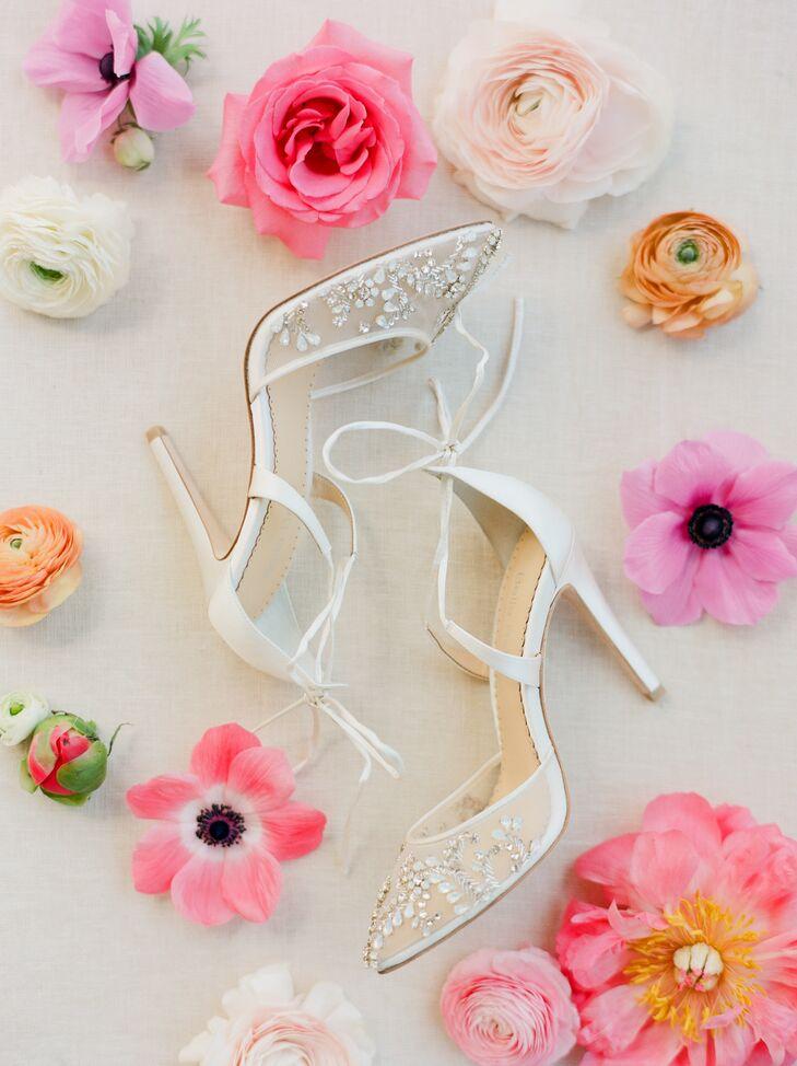 Deborah wore a pair of pointed-toe white lace heels by Bella Belle.