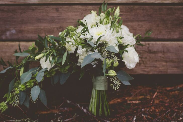 Megan wanted only white blossoms for the bouquet, so Sitka, Alaska, florist Chocolate Moose chose lots of fresh, bright blooms and paired them with plenty of greenery.