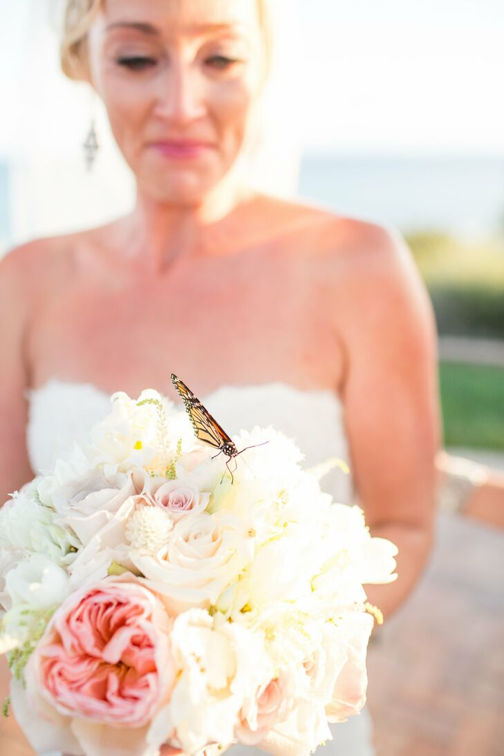 The bride and groom wrote their own vows and had a butterfly release in honor of their future together.  After the ceremony they were taking pictures with the family and one of the butterflies landed on the bride's bouquet.