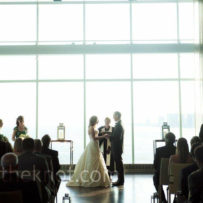 The couple set the altar with two simple lanterns so as not to distract from the ocean view behind them.