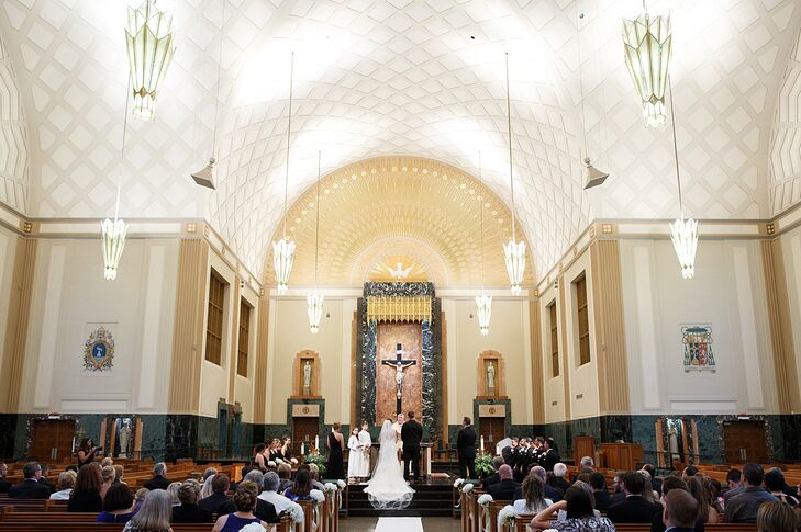 Newlyweds Kristen and Alex exchanged vows in an intimate, religious ceremony at a Joliet, Illinois, church before retreating to Chicago's Loop for their wedding reception at the Millennium Knickerbocker Hotel Chicago.