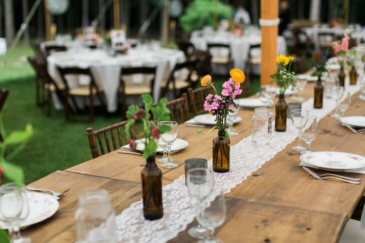 Capturing the charm of the woodland setting, the reception exuded New Hampshire charm with its wooden farm tables, brilliant wildflower bouquets, lace table runners and vintage floral china.