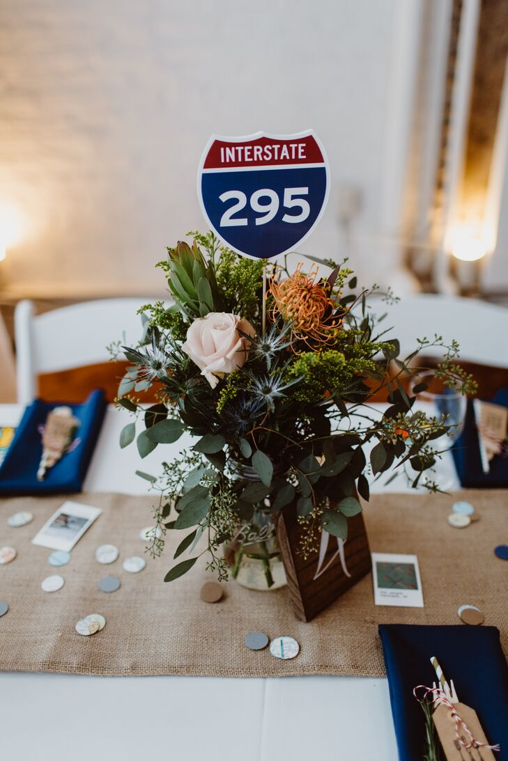 Becka and Reggie incorporated highway signs from California, Pennsylvania and New Jersey into their centerpieces, a personality-packed detail that served as a nod to their travels together.