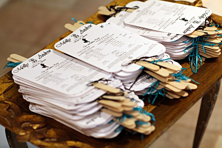 For the summer ceremony, Molly and Andrew gave their guests programs that doubled as fans. The programs were decorated with teal ribbon bows.
