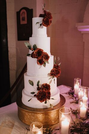 Luxurious Fondant Wedding Cake with Red Roses and Gold Stand