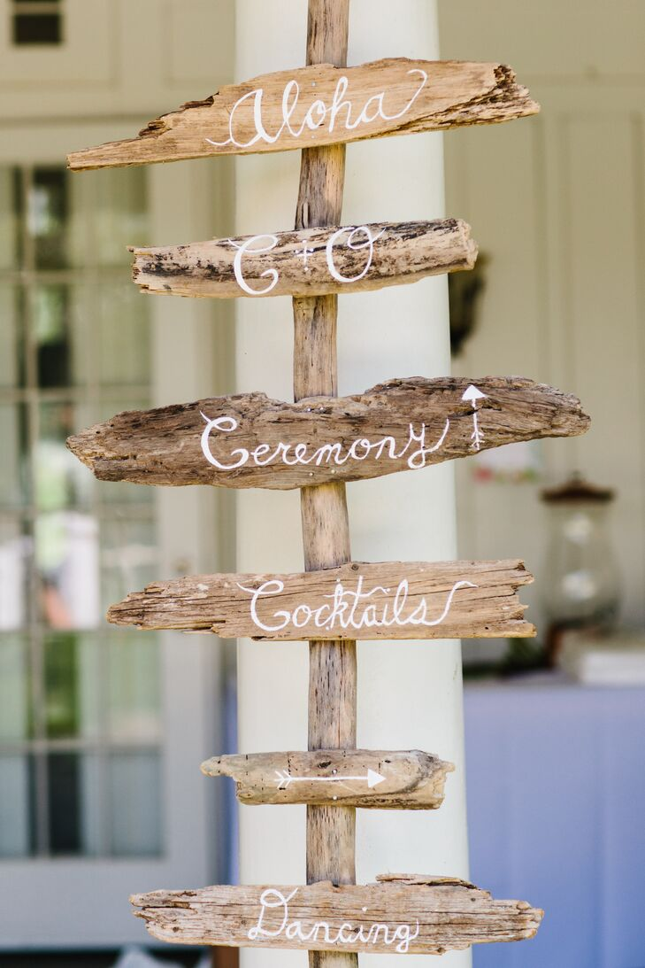 """I am crafter at heart, so I used every opportunity to add my personal DIY touch,"" Olivia says. ""To direct guests one of my first projects was creating an entrance sign made out of driftwood found from local beaches."""
