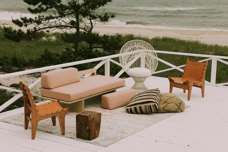 Boho lounge furniture on deck overlooking beach