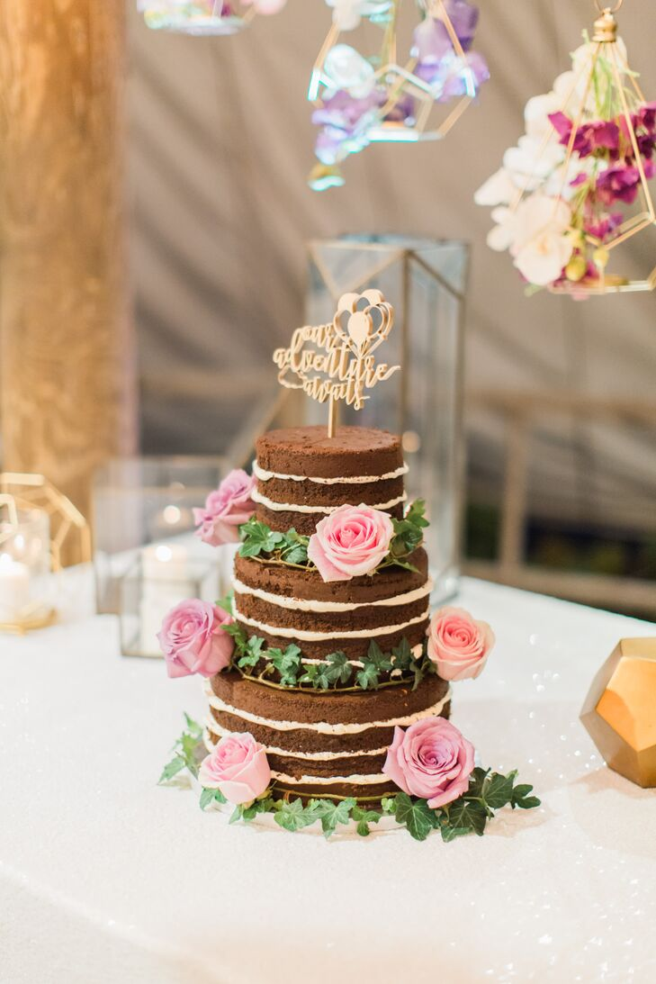 "The couple opted for a naked cake to tie into the laid-back feel of the waterfront locale, while details such as sequin-studded linens and hanging geometric terrariums lent a note of whimsy to the dessert display. As a nod to the Disney move ""Up,"" Victoria and Kenneth adorned their ivy-trimmed confection with a laser-cut wooden cake topper that read, ""Adventure awaits."""