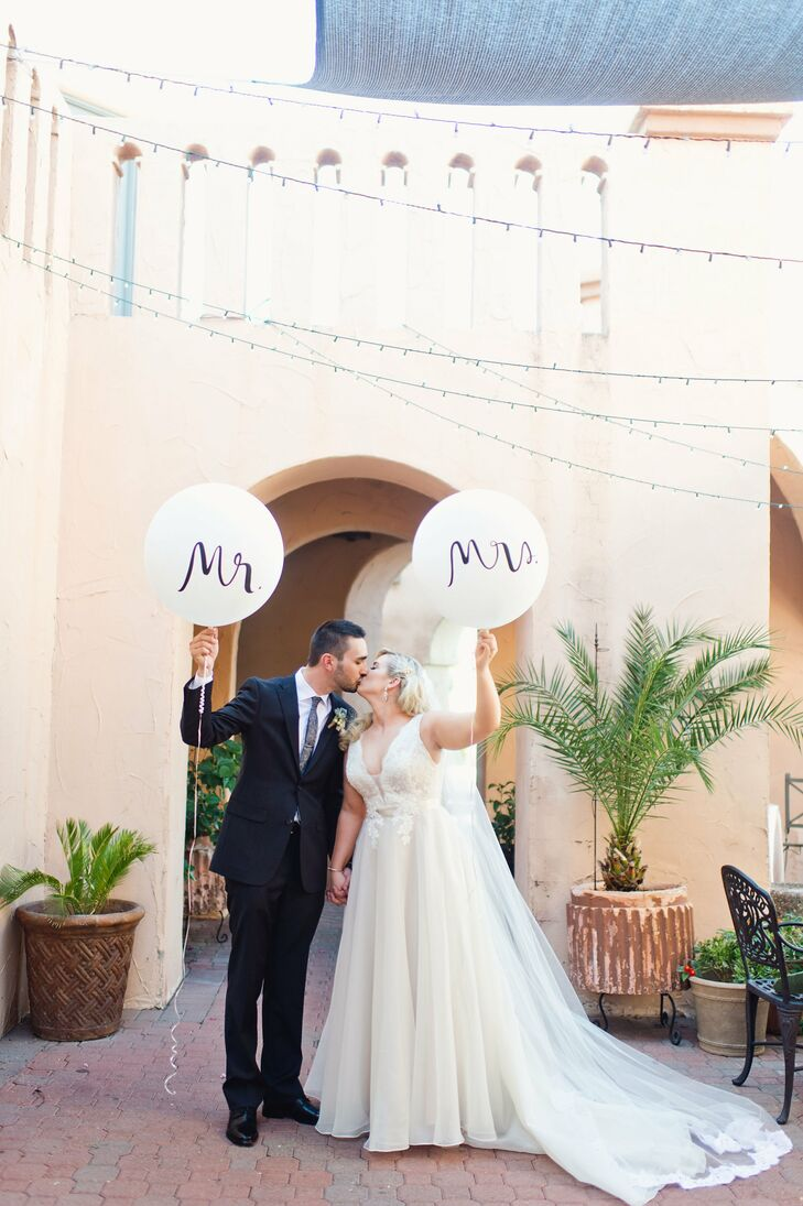 """I wanted to highlight my desert roots by incorporating cacti and succulents and the warm colors or Arizona,"" says Liz, who married Mark at the picturesque Aldea at Tlaquepaque in Phoenix, Arizona."